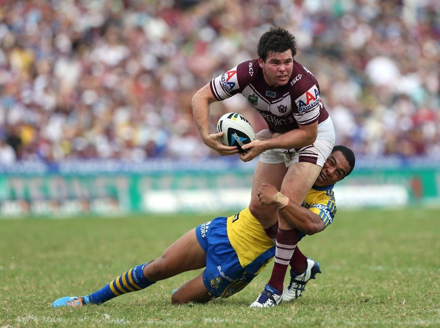 Digital Image by Robb Cox ©nrlphotos.com : Will Hopoate tackles Jamie Lyon : NRL Rugby League - Round 3; Manly-Warringah Sea Eagles V Parramatta Eels, Brookvale Oval.  Sunday the 23rd of March 2014.