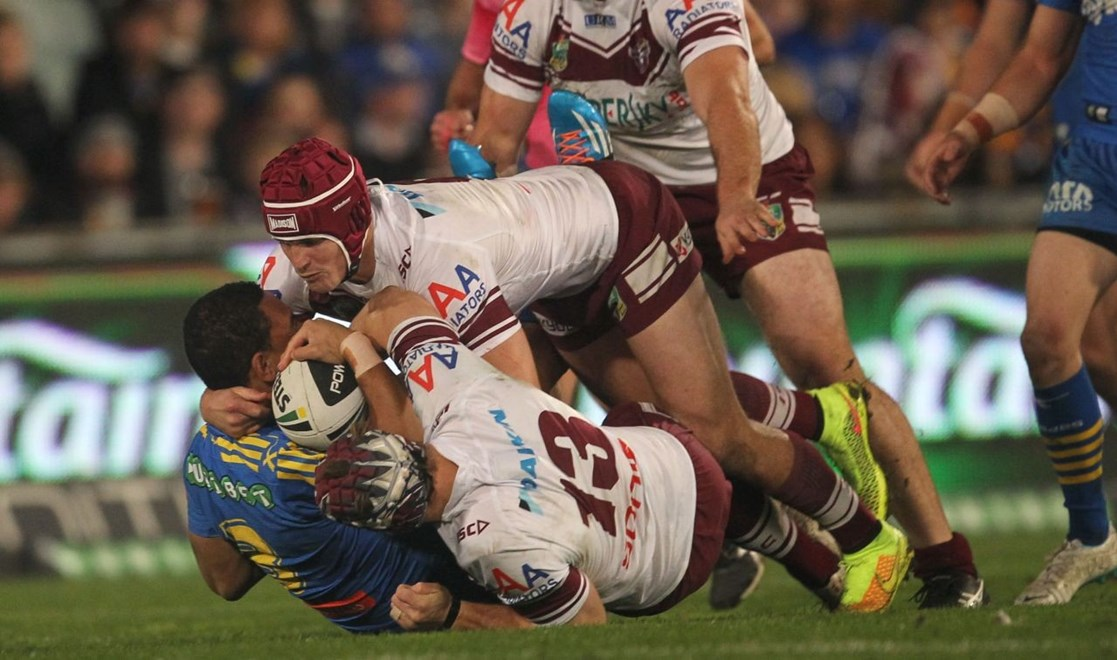 Photo by Colin Whelan copyright © nrlphotos.com :       Will Hopoate smashed back by Matt Ballin and Jamie Buhrer                        NRL Rugby League, Round 24 Parramatta Eels v Manly Warringah Sea Eagles at Parramatta Stadium, Friday August 22nd 2014.