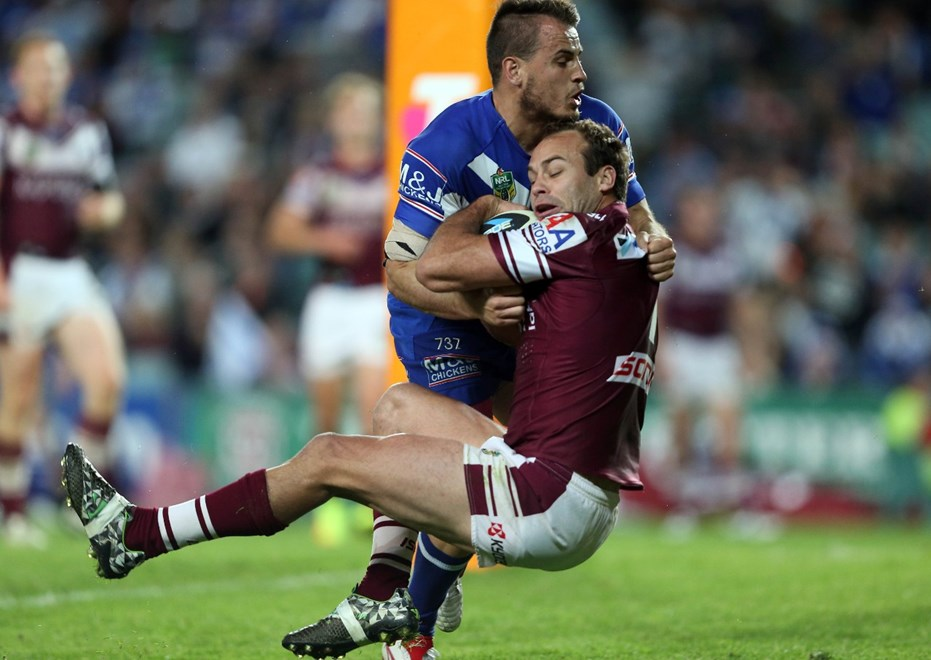 Digital Image by Robb Cox ©nrlphotos.com: Josh Reynolds tackles Brett Stewart in the in goal :NRL Rugby League - Finals Week 2, Manly-Warringah Sea Eagles V Canterbury-Bankstown Bulldogs at Allianz Stadium, Saturday September 20th 2014.