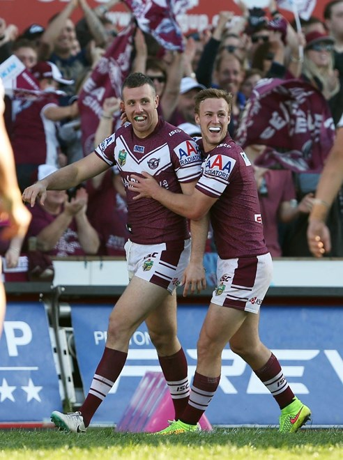 Digital Image by Robb Cox ©nrlphotos.com: James Hasson celebrates his try with Daly Cherry Evans :NRL Rugby League - Round 25, Manly Warringah Sea Eagles V Penrith Panthers at Brookvale Oval, Sunday August 31st 2014.