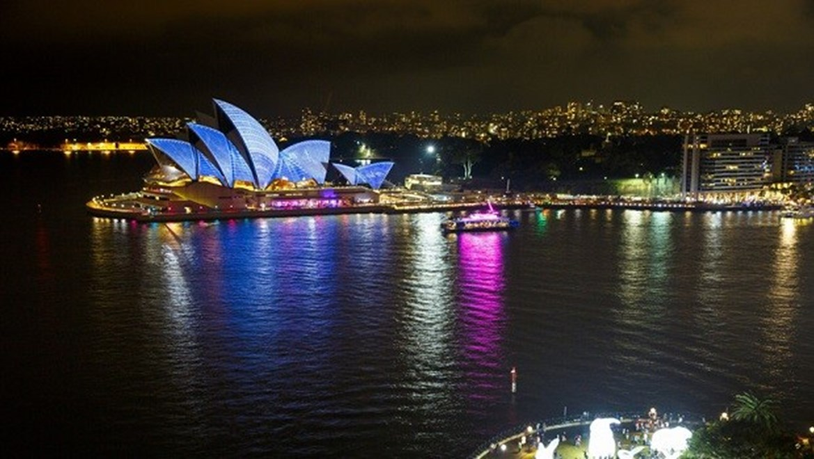 The Sydney Opera House sails light up Sydney harbour for Vivid Sydney 2014.  View from the Sydney Harbour Bridge.