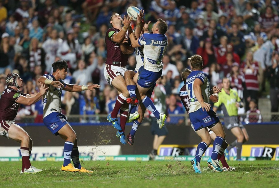 Cheyse Blair and Brett Morris fight for the ball   :Digital Image by Grant Trouvile © NRLphotos  : 2015 NRL Round 2 - Manly Sea Eagles v Bulldogs at Brookvale, Friday 20th 2015.