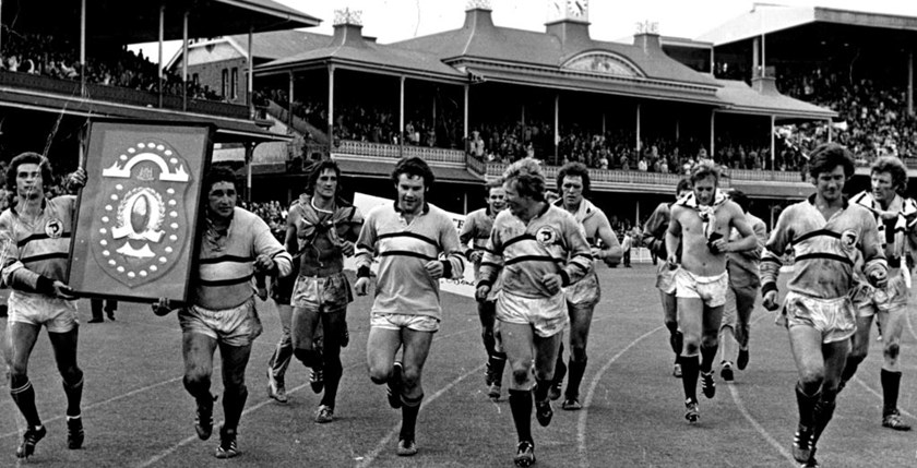 Our 1973 Premiers enjoy their victory lap after 10-7 win over Cronulla. Manly team: Eadie, Irvine, Branighan, Fulton, Brown, Martin, Mayes, Reilly, Randall, Peters, O'Neill, Jones (C), Hamilton, Bench: Bucknall. Coach Ron Willey